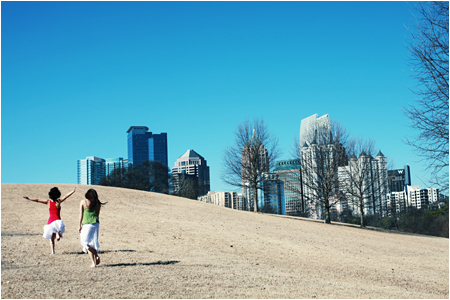 Hillside in Piedmont Park with a view of Atlanta Skyline