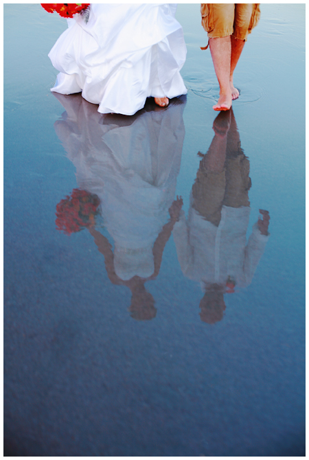 Reflection of Bride and Groom on Water Swept Beach