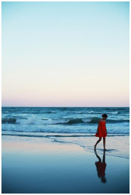 Bridesmaid in Orange against a Blue Ocean Beach Scene